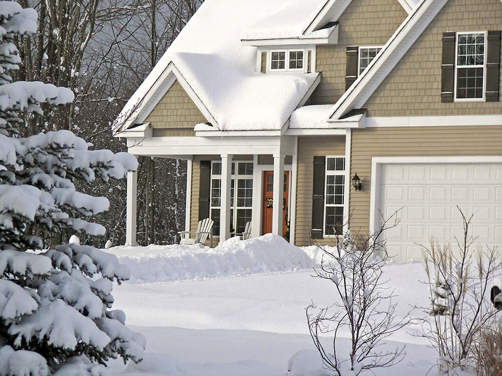 House with Snow on Roof
